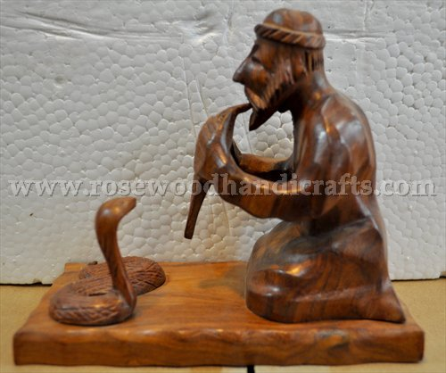 Wooden Man With Snake