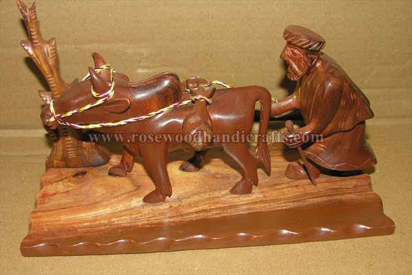 Wooden Man With Bull Statue